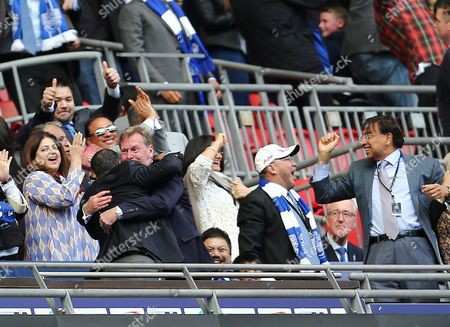 QPR CEO Philip Beard hugs chairman Tony Fernandes after Bobby Zamora scored the winning goal of the game