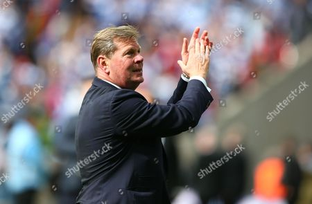 QPR Chief Executive Philip Beard applauds the supporters after full time