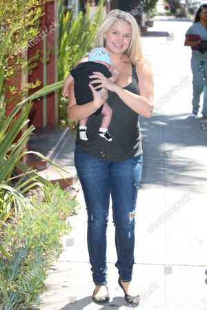 Stock Picture of Tiffany Thornton with baby Kenneth James Carney