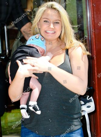 Stock Photo of Tiffany Thornton with baby Kenneth James Carney