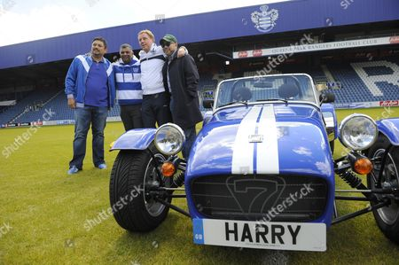 QPR manager Harry Redknapp poses with a personalised Caterham car with the club co-owners, l-r Ruben Emir Gnanalingam, Tony Fernandes and Kamarudin Bin Meranun