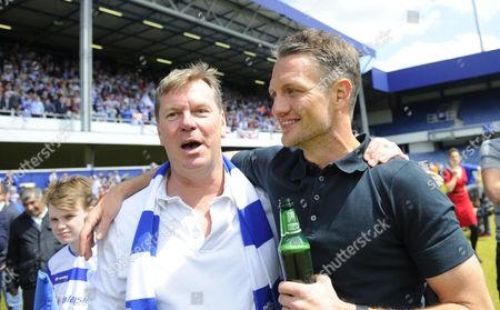 Clint Hill of QPR continues the party with Chief Executive Philip Beard