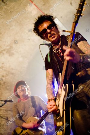 Stock Image of The New York Dolls in concert at The Old Vic Tunnels, London - Sylvain Sylvain and Earl Slick