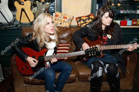 Stock Photo of Allison Robertson and Maya Ford of the Donnas in a guitar shop in Denmark Street, London