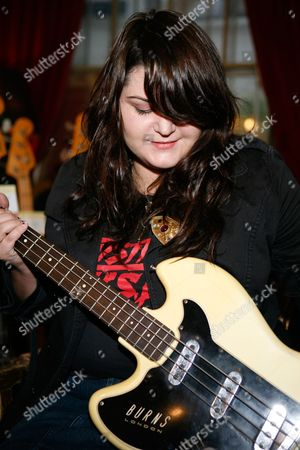 Maya Ford, bassist with the Donnas in a guitar shop in Denmark Street, London