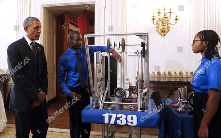 United States President Barack Obama looks at the First Robot project of Lydia Wolfe (r) and Jane Merrow (c)