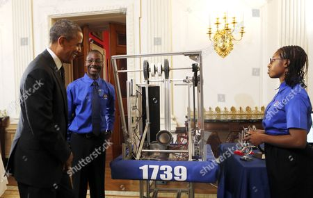 Stock Photo of United States President Barack Obama looks at the First Robot project of Lydia Wolfe and Jane Merrow