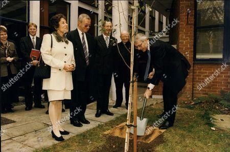 Prime Minister John Major & Gillian Shephard Planting A Tree At The Cardinal Vaughan Memorial School In London.