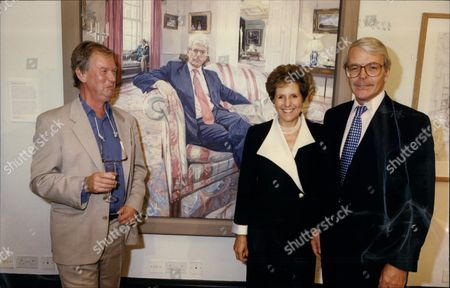 Prime Minister John Major & Wife Norma Major With Artist John Wonnacott. They Are Standing In Front Of Painting Of John Major By John Wonnacott At The National Portrait Gallery.