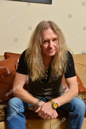 Brighton United Kingdom - February 14: Doug Scarratt Guitarist Of British Heavy Metal Band Saxon Photographed During A Portrait Shoot At His In Brighton February 14