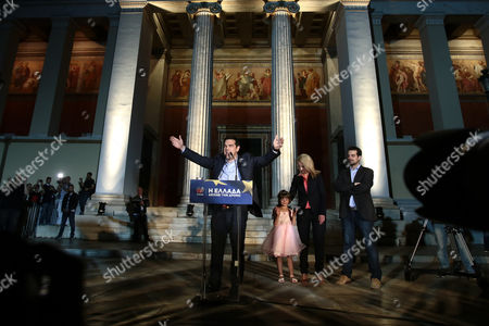 Syriza President Alexis Tsipras celebrates the party's win at the european parliament elections, together with newly-elected Athens governor, Rena Dourou