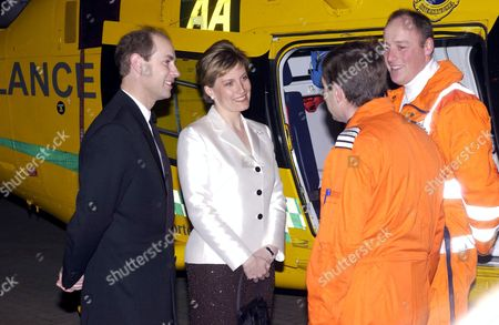 PRINCE EDWARD AND SOPHIE COUNTESS OF WESSEX MEETING CREW MEMBERS ANDY BUSBY (PILOT) AND TIM GODDARD (PARAMEDIC)