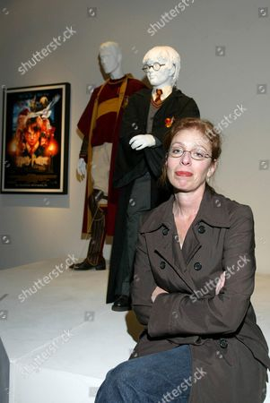 COSTUME DESIGNER JUDIANNA MAKOVSKY WITH COSTUMES FROM THE FILM 'HARRY POTTER AND THE PHILOSOPHER'S STONE'