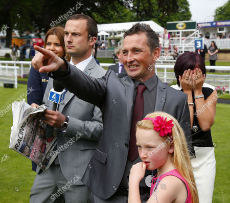 Craig Brazier winner of the Scoop6 last week shouting home Tumblewind for the £5 million bonus with his family Tracy Jessica and Casey with Tom Lee of Channel 4 York
