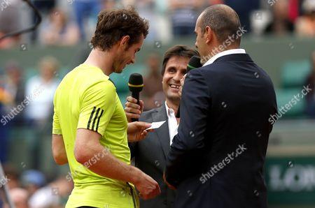 Andy Murray of Great Britain jokes with Cedric Pioline and Fabrice Santoro