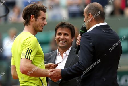 Andy Murray of Great Britain jokes with Cedric Pioline