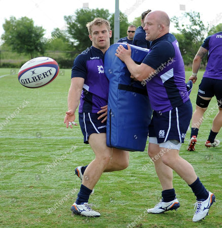 Pat MacArthur - Scotland, hits the impact bag held by fellow hooker Scott Lawson  