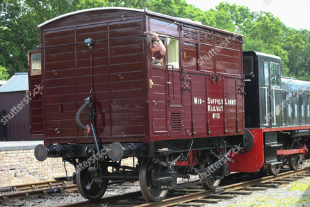 Stock Picture of John Stark from the Mid-Suffolk Light Railway with the newly restored Horsebox No 180