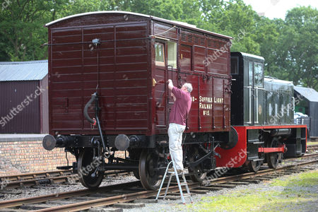 Stock Image of John Stark from the Mid-Suffolk Light Railway with the newly restored Horsebox No 180