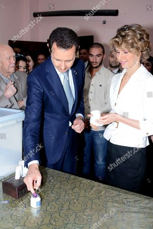 Stock Picture of Bashar al-Assad and Asma al-Assad