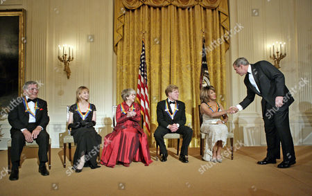 United States President George W. Bush congratulates Tina Turner during a reception for the Kennedy Center Honors in the East Room of the White House. From left, the honorees are singer Tony Bennett, dancer Suzanne Farrell, actress Julie Harris, actor Robert Redford and singer Tina Turner.