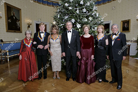 United States President George W. Bush and first lady Laura Bush pose with the 2005 Kennedy Center honorees. From left to right, actress Julie Harris, actor Robert Redford, singer Tina Turner, ballet dancer Suzanne Farrell and singer Tony Bennett.