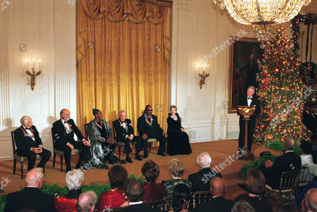 1999 Kennedy Center Honorees Victor Borge, Sean Connery, Judith Jamison, Jason Robards and Stevie Wonder with first lady Hillary Rodham Clinton listen to United States President Bill Clinton's remarks at a White House reception in their honor hosted by President and Hillary Clinton.
