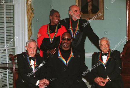 Group shot of the 1999 Kennedy Center Honorees at the State Department. Left to Right: Jason Robards, Judith Jamison, Stevie Wonder, Sean Connery and Victor Borge.