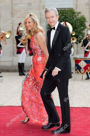 French CEO of LVMH Bernard Arnault and his wife, pianist Helene Arnault, pose as they arrive for a state dinner at the Elysee presidential palace in Paris, on June 6, 2014, following the international D-Day commemoration ceremony on the beach of Ouistreham, western France, marking the 70th anniversary of the World War II Allied landings in Normandy./VILLARD_VILL090/Credit:VILLARD/SIPA/1406062338