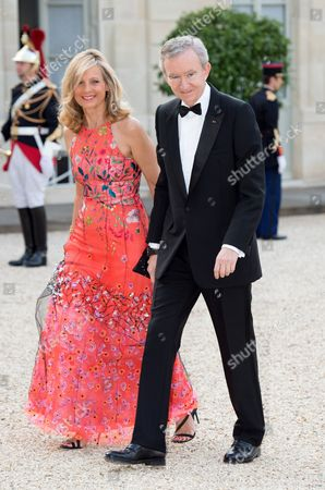 French CEO of LVMH Bernard Arnault and his wife, pianist Helene Arnault, pose as they arrive for a state dinner at the Elysee presidential palace in Paris, on June 6, 2014, following the international D-Day commemoration ceremony on the beach of Ouistreham, western France, marking the 70th anniversary of the World War II Allied landings in Normandy./VILLARD_VILL085/Credit:VILLARD/SIPA/1406062338