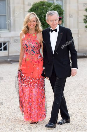 French CEO of LVMH Bernard Arnault and his wife, pianist Helene Arnault, pose as they arrive for a state dinner at the Elysee presidential palace in Paris, on June 6, 2014, following the international D-Day commemoration ceremony on the beach of Ouistreham, western France, marking the 70th anniversary of the World War II Allied landings in Normandy./VILLARD_VILL083/Credit:VILLARD/SIPA/1406062338