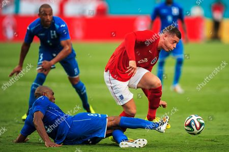 Ross Barkley of England is tackled by Wilson Palacios of Honduras