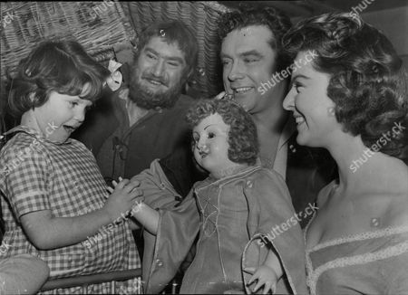 Stars Of The Tv Series 'robin Hood' L-r: Archie Duncan (little John) Richard Greene (robin Hood) And Bernadette O'farrell (maid Marion) With Christine James Aged Five Of West Ham Receives A Doll On Behalf Of The Children's Ward At St. Mary's Hospital Plaistow.
