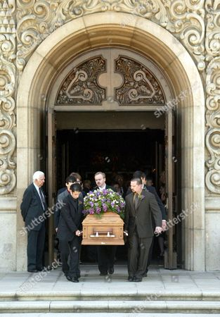 Robert Urich's coffin leaves the church