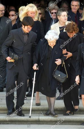 Stock Photo of Robert Urich's mother Cecelia is helped down the church steps by grandson Ryan.