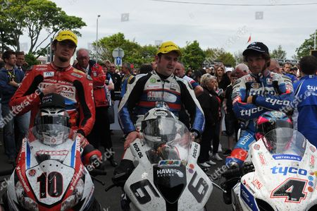 Connor Cummins, Michael Dunlop and Guy Martin in park ferme after the Senior race