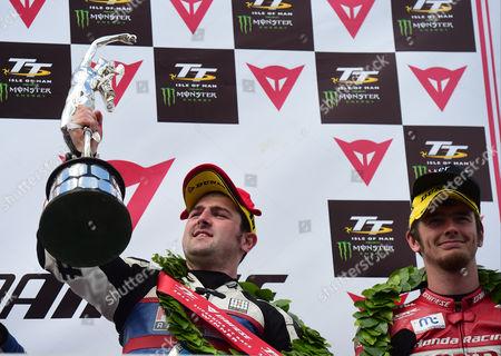 Michael Dunlop after winning TT Superbike race with Connor Cummins