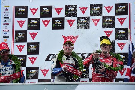 Michael Dunlop after winning TT Superbike race with Connor Cummins and Guy Martin