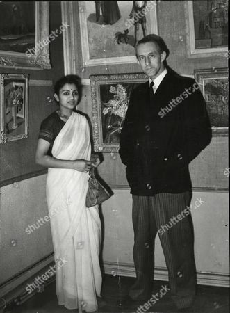 Stock Picture of Mr Christmas Humphreys Q.c. With Miss Usha Rani When He Opened An Exhibition Of Eastern And Western Paintings At The Irving Gallery.