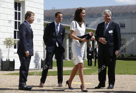 Catherine Duchess of Cambridge, Sir Ben Ainslie (second left), Sir Charles Dunstone, co-founder of Carphone Warehouse (left), and Sir Keith Mills
