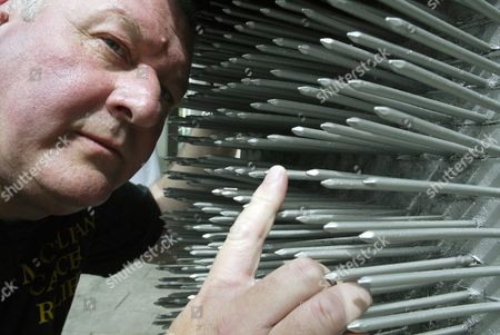 ROY SINGFIELD WITH HIS BED OF NAILS