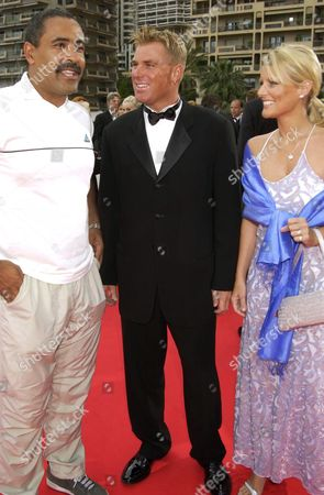Daley Thompson with Shane Warne and wife Simone