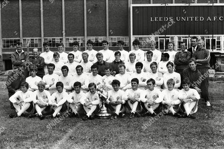 Stock Picture of Football - 1969 / 1970 season - Leeds United photocall Full Squad team group at Elland Road. Back Row (left to right): Don Revie (manager), Robert 'Bob' English (physio), Keith Edwards, James 'Shaun' O'Neill, Chris Galvin, David Kennedy, Norman Hunter, Rod Belfit, Eddie Gray, Terry Yorath, B. Mundell, Cyril Partridge (trainer), Maurice Lindley (assistant manager), Syd Owen (coach). Third Row: Allan Clarke, Mike O'Grady, Jackie Charlton, Garry Sprake, David Harvey, Mick Jones, Paul Madeley, Albert Johannson. Second Row: Les Cocker (trainer), David Walls, Paul Reaney, Nigel Davey, Terry Cooper, Terry Hibbitt, Johnny Giles, Billy Bremner, Mick Bates, Jimmy Lumsden, Paul Peterson, Derek Edmonds. Front: Colin Smith, Robert Malt, Robert Danskin, S. Brown, Sean Grace, Jimmy Mann, Robert 'Bobby' Rutherford, Brian Stuart, P. Thrussell, Peter Hearnshaw.