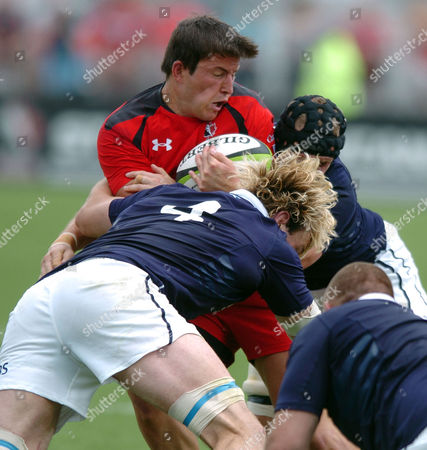 DTH Van der Merwe - Canada winger is tackled by Richie Gray and Kieran Low Please credit: ***Fotosport/David Gibson***