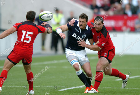 Stock Image of Sean Lamont - Scotland centre competes for the lose vball with Canada full back James Pritchard