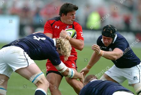 DTH van der Merwe - Canada winger is tackled by Richie Gray and Kieran Low