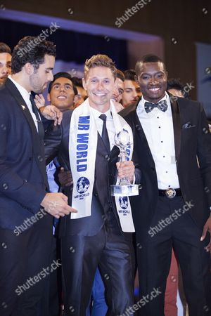 Stock Photo of Mr. World winner Nicklas Pedersen (23) from Denmark (centre) with runners-up Jose Pablo Minor from Mexico and Emmanuel Ifeanyi Ikubese from Nigeria