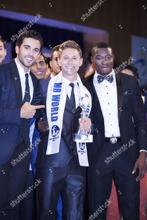 Mr. World winner Nicklas Pedersen (23) from Denmark (centre) with runners-up Jose Pablo Minor from Mexico and Emmanuel Ifeanyi Ikubese from Nigeria