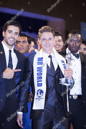 Stock Picture of Mr. World winner Nicklas Pedersen (23) from Denmark (centre) with runners-up Jose Pablo Minor from Mexico and Emmanuel Ifeanyi Ikubese from Nigeria