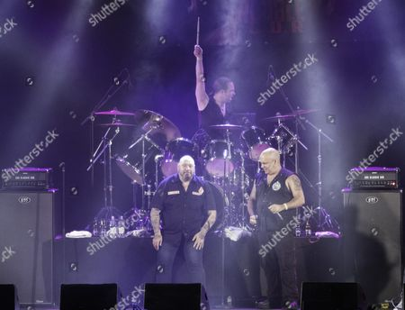 Stock Photo of Two of Iron Maidens original singers - Blaze Bayley (original singer in Iron Maiden between 1993 - 1999) and Paul DiAnno (original singer in Iron Maiden between 1978 - 1981) performing in 'Blaze Bayley vs Paul DiAnno'